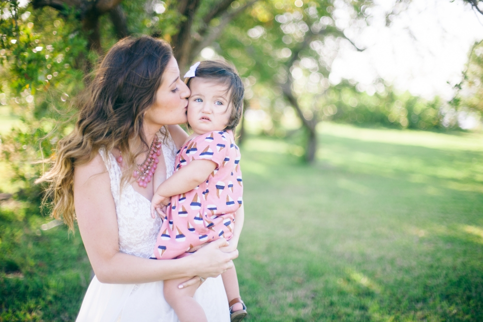 mom and daughter kissing in key biscayne florida, outdoor family portraits in miami florida